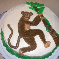 Monkey  Pumpkin cake w/ Cream cheese icing-- Delicious! I was pleased with how the monkey came out since I drew him freehand. The boarder is long...