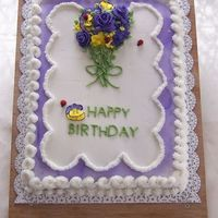Pansies And Violets Birthday cake for group birthday. Buttercream with royal icing flowers,