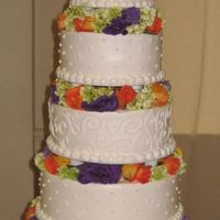 Img_0559.jpg 6,8,10,12,14 round cakes with fresh flowers in between. All buttercream.
