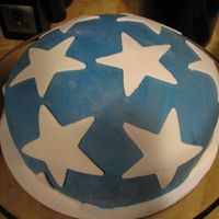 Star Cake  First attempt at fondant. Learned to mix the color into the wet mixture rather than after having put the completed fondant to chill. My...