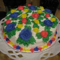 Multi Color Flower Cake   One of my first cakes. Just went crazy expermenting with colors and flowers