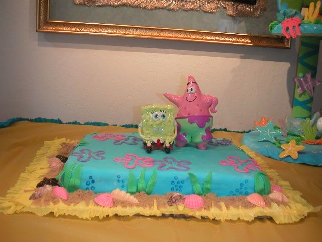 Spongebob Cake First time making mmf, shells and flowers are candy melts