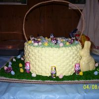 "Easter Basket Cake Two Layer 10""x3"" Round Cake with basketweave. The green grass is coconut. The handle I made out of gift bags. I just took them..."
