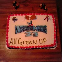 Wrestle Mania 23 Cake  I did this cake for my fiance and his brother who are wrestling fanatics!!! I traced the logo with a rose nail then did the lettering with...