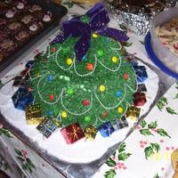 3-D Christmas Tree Cake  I did this cake with the same layering effect like I was doing a Barbie cake. I did the green with a star tip and sprinkled with powdered...