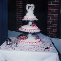 My Very First Wedding Cake This was my first wedding cake I have ever done. I did it for my big brother. It has fresh pink roses and corneli lace. Not bad for my...