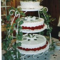 "Fresh Red Rose Wedding Cake All layers on this cake are 3"" thick with all of them having basket weave on the side."