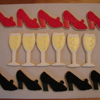 Champagne Glasses And High Heel Shoes I made these for a customer who ordered three dozen ccokies(a dozen of each style) for a friends birthday. NFSC/RI