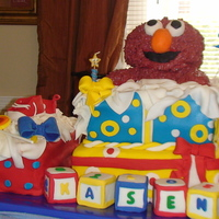 Elmo Present Cake Soooo soooo upset when my icing on elmo's body just kept getting darker. Actually cried