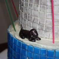 Fondant Dachshund The little decorative dachshund for my friend's b'day cake. Made of fondant and painted after assembly.