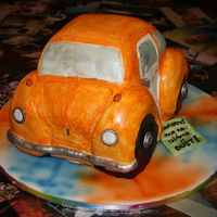 "Vw Beetle Sculpted VW Bug for a h.s. graduation/going away party. I airbrushed the ""tie-dye"" on the board. (my first successful car cake)..."