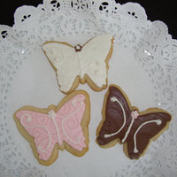 Baby Shower Butterflies Butterfly-shaped sugar cookies w/fondant (Satin Ice, embossed) and RI w/fondant (SI) pearls. Made 2 dozen for a co-worker.