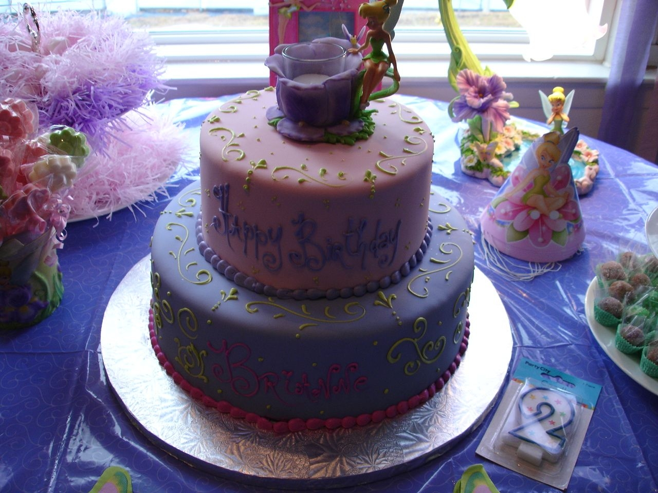 Tinkerbell Cake  This was a Tinkerbell cake done for my daughter's 2nd birthday party. I didnt' do it myself, but I loved what the pastry shop did...