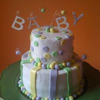 Sharon's Baby Shower Gender of the baby was unknown. WASC cake filled with strawberry (bottom) and apricot (top). Covered in BC with MMF accents. The letters...