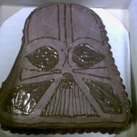 Darth Vader I couldn't order the Darth Vader character pan in time, so I just carved this out of an 11x15 sheet cake. It's chocolate cake...