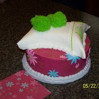 Allie's 4Th Slumber Party CakeIced in BC with Fondant Accents. Pillow is iced in BC and covered with Fondant. Fuzzy slippers are made from Fondant then...