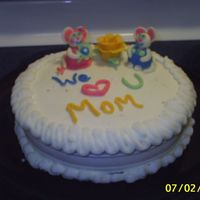 Mice For Mom White cake with chocolate whipped pudding filling and buttercream icing. The mice, flower, and writing is made from white chocolate candy...