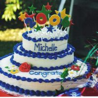 Graduation Cake A surprise graduation cake for my cousin. I was going for a whimsical theme. The bottom layer is chocolate cake, the middle layer is yellow...
