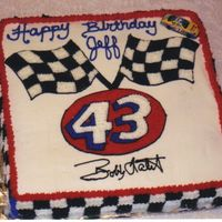 Nascar Cake This cake was half chocolate and half vanilla with buttercream icing. It was a surprise for a costumer who loves nascar and Bobby Labonte...