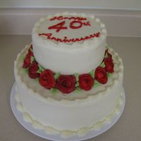 40Th Anniversary This is a two tiered carrot cake I did for a 40th Anniversary celebration. The customer requested red.