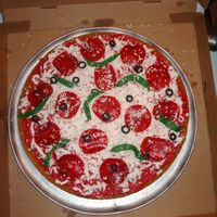 "Pizza Cake made this for my son's 9th birthday. White cake w/strawberry b/c for ""sauce"" grated fondant for cheese and fondant toppings..."