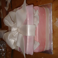 Pink Gift Box Made thisas a practice. This was my first time trying an open gift box. The lid and bow were made out of fondant. Not too thrilled with the...