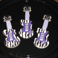 Hanna Montana Guitar Cookies NFSC w/ Carmie00 icing, royal details, This customer did a Hanna Montana birthday party and requested a guitar specifically with purple...
