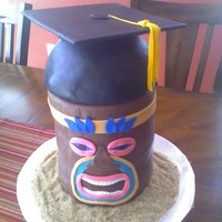 Graduation Tiki Chocolate cake with chocolate fondant. The cap is RKT.