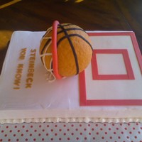 Basketball Cake Half chocolate cake, half vanilla. Covered in Pastry Pride. Ball is RKT covered in fondant. All other decorations are fondant.