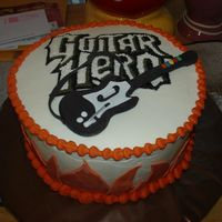 Guitar Hero Cake for a big fan of Guitar Hero. Those are suppose to be flames on the side, but it didn't look like it to me.