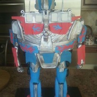 Optimus Prime Optimus Prime for a groom. Legs are pipes.