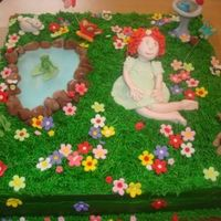 Garden Cake This was a cake for a girl's 2nd birthday. The mom just told me to make her daughter sitting in a garden. I wanted to make it more...