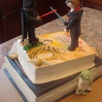 Harry Potter Fighting Darth Vader Graduation Cake I made this cake for a girl who graduated from High School. She wanted Harry Potter fighting Darth Vader. I though that was a weird request...