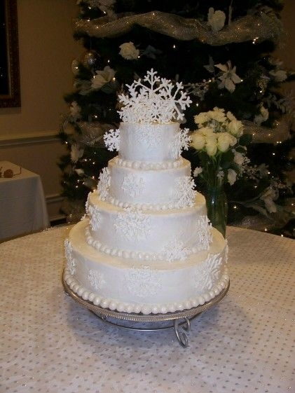 Snowflake Wedding Cake Here is a my second attempt to make a wedding cake. It was for a winter wonderland themed wedding. Buttercream iced with royal icing...