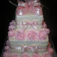 Laces_Pics_023.jpg  Layers of white with straberry mousse and chocolate with caramel mousse. Iced in bc with bc roses snd scroll work. and baby shoes are made...