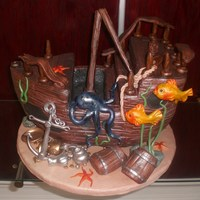 Suken Treasure Ship  Chocolate Kahlua cake filled with dark chocolate truffle. Iced in buttercream and covered with fondant. All ship detailing, sea creatures...