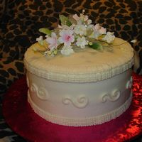 Hat Box This was for my daughters' boss' birthday. Buttercream with gumpaste flowers. I had so much trouble the the tip used for the...