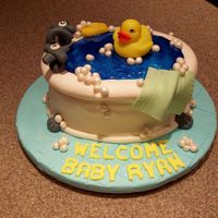 Rubber Duckie, You're The One!  Cake for a baby shower this past weekend - the faucet handles actually worked and turned!! Fondant covered cake - wilton shimmer gel for...