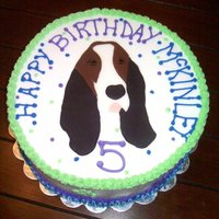 Basset Hound Made for my daughter's birthday. She wanted a basset cake that looks like our dog. LOL! Dog made of fondant pieces matched together...