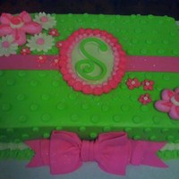 Lime And Pink Initial Cake WASC with Lime buttercream with fondant and buttercream accents.