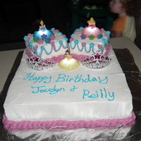 Princess Cake Big cake layered chol and white, whipped frosting with 2 small cakes 1 chol and 1 white with light up princess and crowns to complete the...