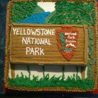 Yellowstone National Park Cake This was a surprise present for a birthday, he got a trip to yellowstone, so I made the cake to match the sign.