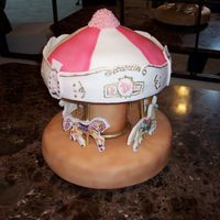 Carousel With Horses And Unicorns This is a 2 tier unicorn and horse carousel cake. Everything is edible. The horses/unicorns are printed on edible paper, the pillar is made...