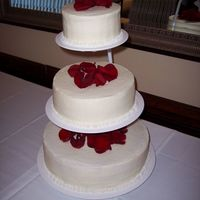 Basic Wedding Cake This is a basic buttercream wedding cake with flower petals on top. Simple but elegant.