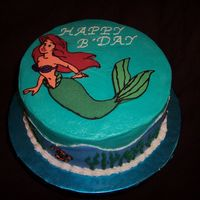 Under The Sea With The Little Mermaid This is a marbled vanilla and chocolate cake with buttercream frosting. Ariel was made using the frozen buttercream transfer technique (my...