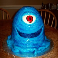 "Bob  A friend and I worked on this cake. Vanilla cake (3-8"" layers an a Wonder Mold layer) covered in blue MMF. Blue tinted piping gel..."