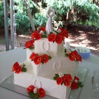 Calla Lilys & Roses   14-10-6 square cake with gumpaste callas, roses, greenery, and horseshoes.
