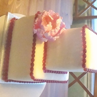 "Ivory Wedding 8"" & 4.5"" red velvet cakes w/ SMBC. Covered with ivory mmf. Decorated with fuschia sugar beads and gumpaste peony. Pretty..."