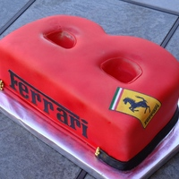B Is For Ferrari... Carved 9x13 red velvet w/ IMBC. Covered w/ MMF. Edible image for Ferrari logos.