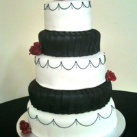 Black & White Wedding Cake Red velvet cake w/ SMBC. Covered w/ marshmallow fondant, gumpaste roses and royal icing detail. Very stressful cake for me as I was in the...